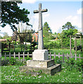TF9828 : War memorial in Stibbard by Evelyn Simak