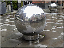 TQ3280 : Decorative Globes, Sermon Lane, London EC2 by Christine Matthews