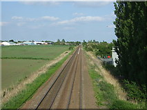 TL4097 : Peterborough to March railway at Peas Hill by JThomas