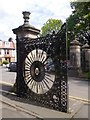 NT1885 : Gateway with ornamental wrought iron gates by Stanley Howe
