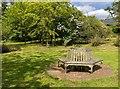 SP5141 : Hexagonal seat, Thenford Arboretum by David P Howard