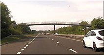 NS3335 : Footbridge over A78 near Pulp works by John Firth