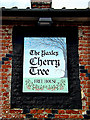 TM1274 : The Yaxley Cherry Tree Public House sign by Adrian Cable