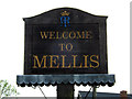 TM1074 : Mellis Village sign by Adrian Cable