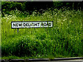TM0572 : New Delight Road sign by Adrian Cable