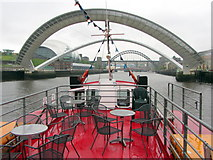 NZ2563 : Gateshead Millennium Bridge opens for River Escapes vessel, Fortuna by Andrew Curtis