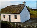 M3810 : White Thatched-Roof Cottage along west side of N67 near Dunguaire Castle by Suzanne Mischyshyn