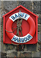 NJ6864 : A lifebelt at Banff Harbour by Walter Baxter