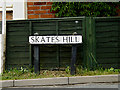 TL8346 : Skate's Hill sign by Adrian Cable