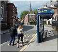 SJ4912 : Walkers and a bus shelter, Dogpole, Shrewsbury by Jaggery