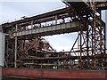 SJ6874 : Industrial pipe work by Stephen Burton