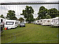 TM1544 : John Davis & Son Funfairs camp area by Hamish Griffin