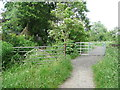 SE2222 : Kissing gate on new path along edge of restored waste tip  by Humphrey Bolton