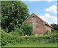 TG0815 : Brick barn by Willows Farm by Evelyn Simak