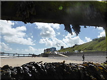 TG2142 : Cromer - sea wall, town and church from storm-damaged groyne by ruth e
