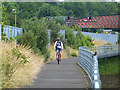 SU4213 : Cyclist on the Itchen Riverside Boardwalk by Oliver Dixon