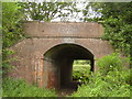 SY1097 : Railway bridge under the old A30 by Anthony Vosper