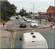 SJ9495 : Hosepipe across Manchester Road by Gerald England