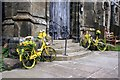 SK2692 : Yellow bikes by the church door by Graham Hogg