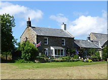 NY9393 : House overlooking Elsdon village green by Russel Wills
