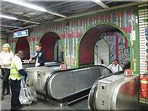 TQ2981 : Tottenham Court Road tube station - Paolozzi mosaic, escalators by Mike Quinn