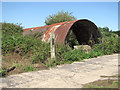 TG0325 : The shell of an old Nissen hut by Evelyn Simak