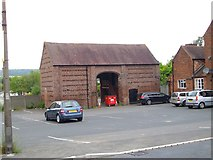 SO8690 : Empty Barn next to The Greyhound Inn by Stephen Rogerson