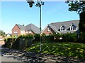 SP0496 : New houses, 1a and 1b Woodfield Close by Alex McGregor