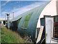 TM0198 : Nissen hut on the Industrial Estate at Stalland Common by Evelyn Simak