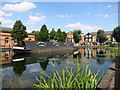 TQ3798 : Canal Boat in the Village by Des Blenkinsopp
