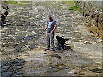 C8540 : Man with dog, Portrush Harbour by Kenneth  Allen