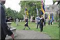 SP9211 : The Flag Bearers approach Tring War Memorial by Chris Reynolds