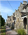SX8570 : Mackrell's Almshouses, Wolborough Street, arched entrances to houses by Robin Stott