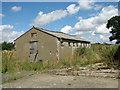 TM1780 : Old RAF building by Evelyn Simak