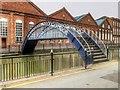 SK9871 : Footbridge over Witham Navigation, Lincoln by David Dixon