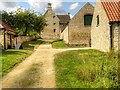 SK9224 : Farmyard and Farm Buildings, Woolsthorpe Manor by David Dixon