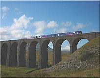 SD7579 : Passenger train crossing the Ribblehead Viaduct by Karl and Ali