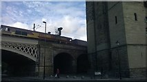 NZ2563 : Freight train heads south past the castle, Newcastle by Christopher Hilton