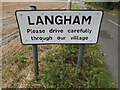 TM0333 : Langham Village Name sign by Adrian Cable