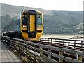 SH6215 : A Pwllheli bound train crosses Barmouth Bridge by John Lucas