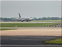 SJ8184 : Airbus A319 Landing at Manchester Airport by David Dixon