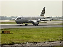 SJ8184 : British Airways Golden Dove at Manchester Airport by David Dixon