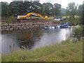 NY2523 : Flooded Defence Work, River Derwent by Mick Garratt