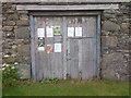 NY2625 : Barn Door/Village Notice Board, Applethwaite by Mick Garratt