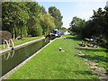 SP8713 : A narrowboat enters Red House Lock, Aylesbury Arm by David Hawgood