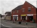 SJ3033 : Gobowen shops near a level crossing by Jaggery