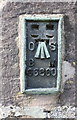 NY7204 : Benchmark on St Oswald's Church by Roger Templeman