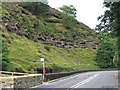 SD9126 : Cornholme - bus stop and exposed rocks by Dave Bevis