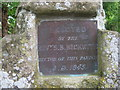 TL3370 : Plaque above well in churchyard, Holywell, Hunts by Michael Behrend