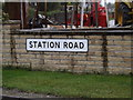 TM0562 : Station Road sign by Adrian Cable